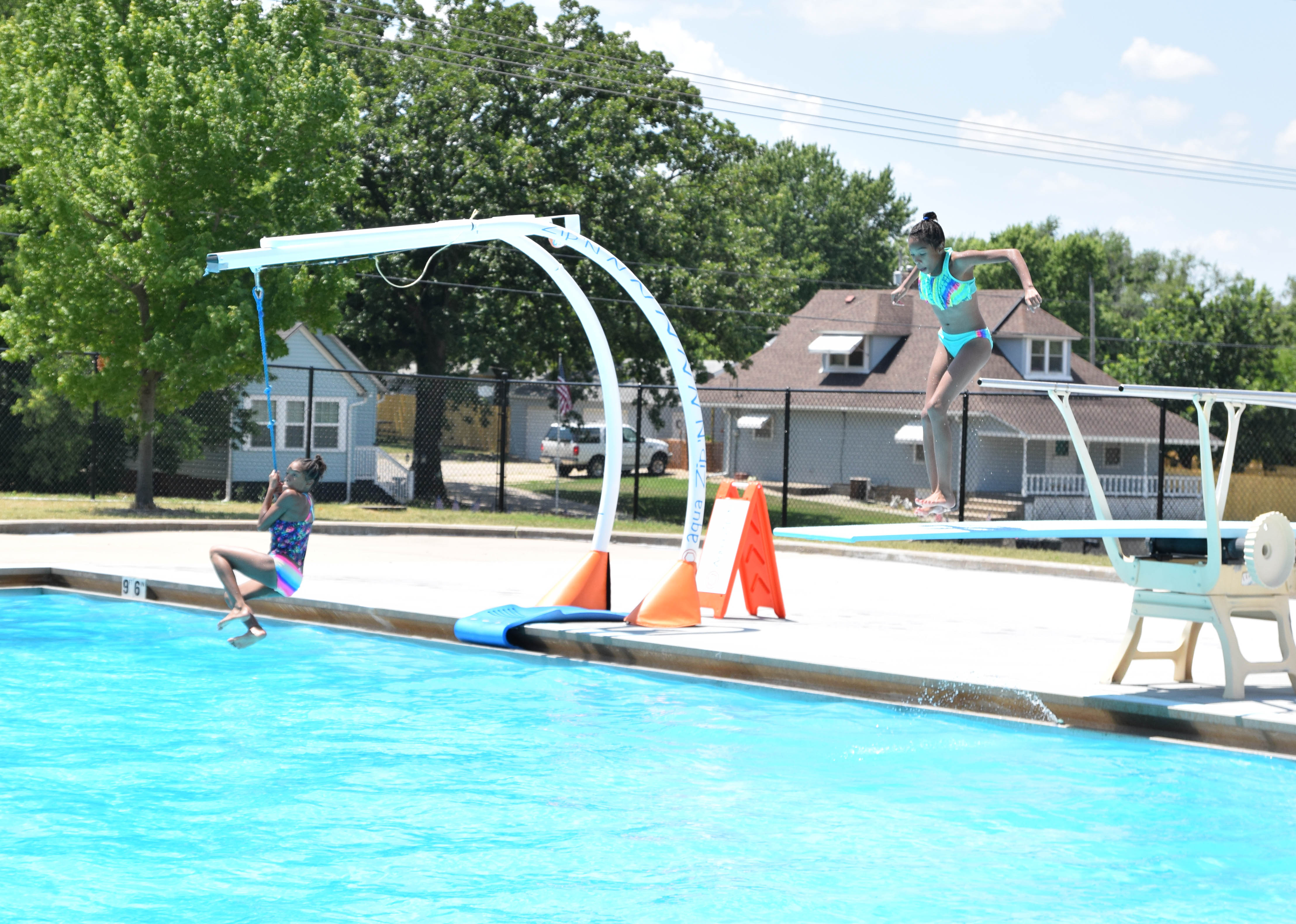 Girls on Aqua Zip&#39n and Diving Board at Hillcrest Pool